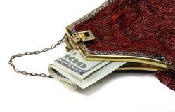 pieniądze z paciorkami torebkę czerwony obrazy stock
