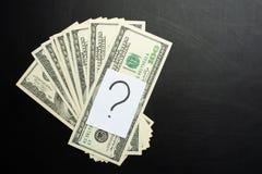 pieniądze z znak zapytania, pojęciem dla gdzie wydawać, inwestycją i depozytem, zdjęcia royalty free