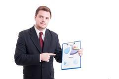 Pieniężne lub kierownik ds. marketingu seansu mapy statystyki Fotografia Royalty Free