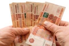 Pieniędzy ruble w rękach na białym tła odosobnieniu obraz royalty free