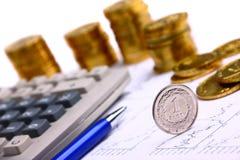 Pieniądze monety, kalkulator Fotografia Stock