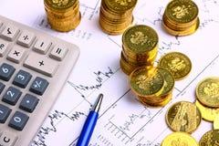 Pieniądze monety, kalkulator Zdjęcia Stock