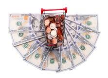 Pieniądze w wózek na zakupy Na bielu Zdjęcie Stock