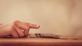 Pieniądze w gracie zawalenie się rynku finansowego kryzys Zdjęcia Stock