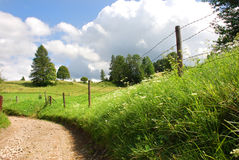 Pieniny Mountains. Road, meadow, barbed-wire fence in the Pieniny Mountains Stock Photos
