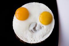 pieno di sole-lato sulle uova Immagine Stock