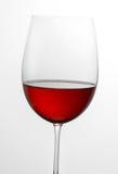 Pieno a metà di vetro di vino rosso Fotografia Stock Libera da Diritti