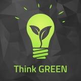 Piense el bulbo verde del eco en fondo oscuro del origamei Fotografía de archivo libre de regalías