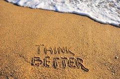 Piense una mejor muestra en una playa de la arena Imágenes de archivo libres de regalías