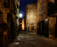 Pienza city street. Night view of beautiful Italian medieval Pienza city with lanterns. Travel outdoor Tuscany background Royalty Free Stock Photos