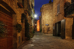 Pienza city street. Night view of beautiful Italian medieval Pienza city with lanterns. Travel outdoor Tuscany background Royalty Free Stock Photography