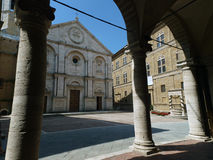 Pienza. Duomo facade. The town of  is a small pearl in the Tuscan countryside. This fantastic town was declared an UNESCO World Heritage Site in 1996 and in Stock Photography