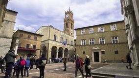 Time lapse of Pienza, tourists stroll through Piazza Pio II. Pienza 2019. Timelapse of tourists stroll through Piazza Pio II. In the background is the Palazzo stock footage
