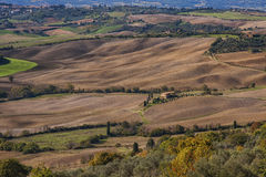 Pienza - Tuscany/Italy, October 30, 2016: Scenic Tuscany landscape with rolling hills and valleys in autumn, near Pienza - Val D` Stock Images