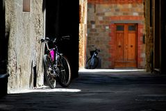 Pienza. Tuscany Italy square  sky windows cloud tower colors country road street courts green door panorama sunset bicycle Stock Photography