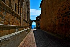 Pienza. Tuscany Italy square  sky windows cloud tower colors country road street courts green door panorama sunset courts Stock Image