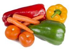 Pieprze, marchewki i pomidory. Fotografia Stock