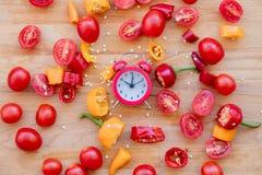 Pieprze, pomidory z budzikiem Zdjęcie Royalty Free
