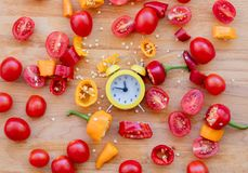 Pieprze, pomidory z budzikiem Zdjęcie Stock