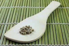 Pieprzowy i drewniany artykuły Zdjęcie Stock