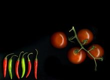 pieprzy pomidory Zdjęcia Stock