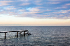 Pier at Øresund. Boat pier at Øresund with a beautiful sunset sky. Malmo, Sweden Royalty Free Stock Photography
