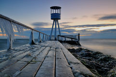 Pier. Filled with ice in the early morning before sunrise Royalty Free Stock Photo