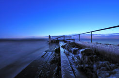 Pier. Filled with ice in the early morning before sunrise Royalty Free Stock Images