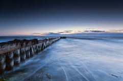 Pier. Filled with ice in the early morning before sunrise Stock Photo