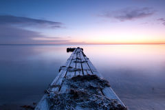 Pier. One early morning before sunrise Stock Images