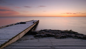Pier. Sunrise at the beach a winter morning Royalty Free Stock Photos