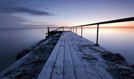 Pier. A early winter morning with ice on the Royalty Free Stock Images