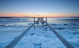 Pier. One winter with ice on the sea Royalty Free Stock Photography