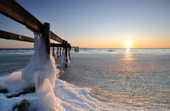 Pier. A pier filled with ice at sunrise Stock Image
