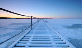 Pier. On a frozen lake Stock Photography