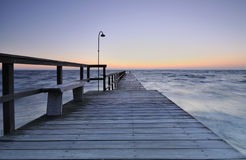 Pier. At the beach in the morning Royalty Free Stock Photography