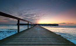 Pier. At sunrise wiht ice at the sea Stock Image