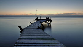 Pier. An early morning just before sunrise Stock Photo