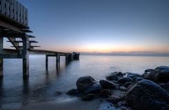 Pier. An early morning just before sunrise Stock Image