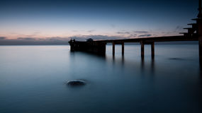 Pier. With a boat on the Royalty Free Stock Image