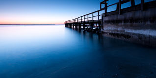 Pier. In the morning before sunrise Stock Photo