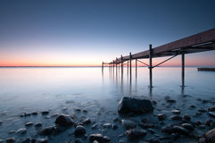 Pier. One early morning just before sunrise Stock Photo