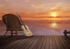On the pier. Sunset on the pier with guitar Royalty Free Stock Photo