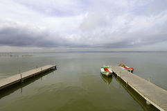 Pier. And wooden boats in Albufera lake, Valencia, Spain Royalty Free Stock Photo