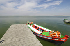 Pier. And wooden boat in Albufera lake, Valencia, Spain Royalty Free Stock Image