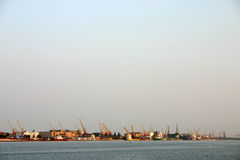Pier. Ships, cranes and boats in lagune Stock Image