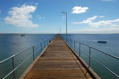 Pier. Ovr the blue sea Royalty Free Stock Photo