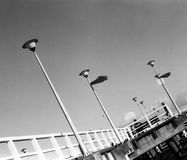 The pier. Pier in Gdansk. On the morning. Photo was taken by camera Mamiya Sekor DTL 1000, Fomapan profi line classic 100/36, classic black and white grainy Stock Image