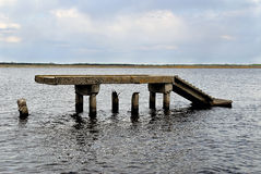 Pier. Part of the destroyed pier in water Stock Photos