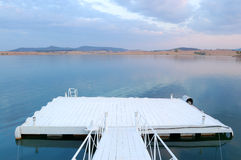 Pier. A small pier on a lake royalty free stock images